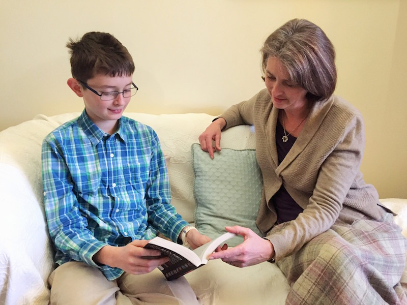 Educational Psychologist reading with boy
